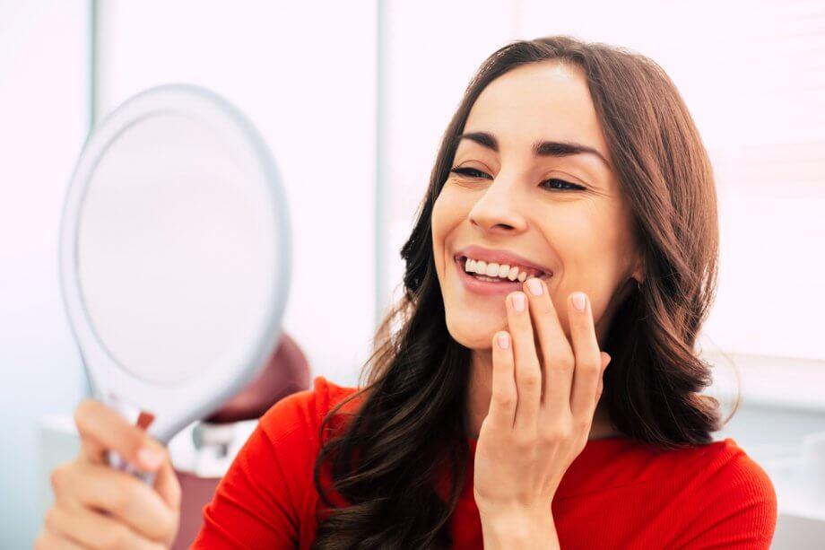 woman looking at teeth