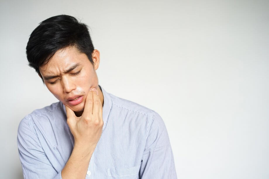 man having tooth pain